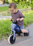 Child on toy bike Royalty Free Stock Images