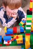 Child with toy blocks. Four years boy playing with colorful blocks Stock Photos