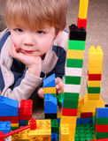 Child with toy blocks. Four years boy playing with colorful blocks Royalty Free Stock Images