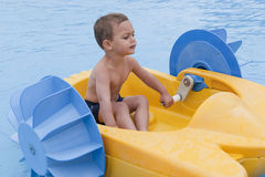 Child on toy boat Stock Photo