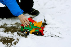 Child with a toy bulldozer Royalty Free Stock Photos