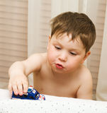 Child with toy car Royalty Free Stock Images