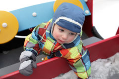 Child in the toy car Stock Photos