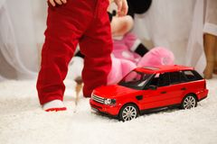 Child with toy car. Child with toy red car. Happy birthday Royalty Free Stock Images