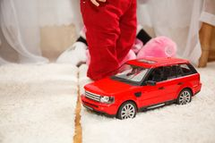 Child with toy car. Child with toy red car. Happy birthday Royalty Free Stock Photo