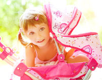 Child with toy carriage Stock Image