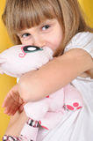 Child with a toy cat Royalty Free Stock Photos