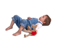 The child with a toy cries. The child with a toy lies on a floor and cries Royalty Free Stock Images