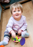 Child with toy on floor Royalty Free Stock Photography