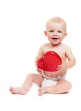 Child with toy in form heart Royalty Free Stock Images