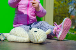 Child with a toy. Child girl with toy bear Royalty Free Stock Photo