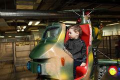 Child on toy helicopter Stock Images