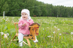 Child on a toy horse Royalty Free Stock Images