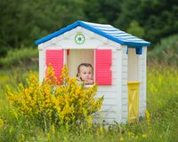 Child in a toy house Royalty Free Stock Photography