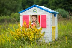 Child in a toy house Royalty Free Stock Images