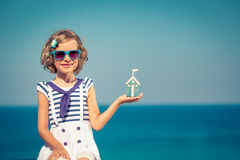 Child with toy house on summer vacation Royalty Free Stock Photography