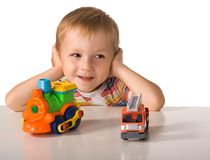 The child with toy machine Royalty Free Stock Images