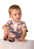 The child with toy machine Stock Photography