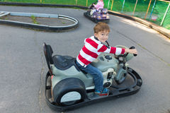 Child on toy motorcycle Royalty Free Stock Photo