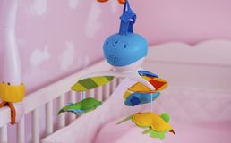 Mobile Child Toy with animals in a pink Baby Room Royalty Free Stock Photography