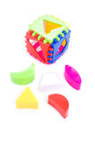Child toy shape sorter. And its pieces over white Stock Photography