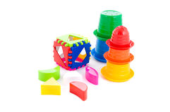 Child toy shape sorter and pyramid. Over white Stock Photography