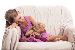 Child with toy taking nap Stock Images