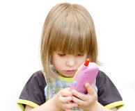 Child with a toy telephone Royalty Free Stock Photo