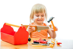 Child with toy tools Royalty Free Stock Photos