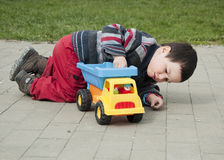 Child with toy truck Royalty Free Stock Photo