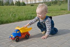 Child with a toy truck. A child playing with a toy truck Royalty Free Stock Photography