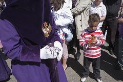 Child with a toy trumpet during a procession of holy week Stock Photography