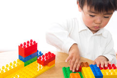 Child and toys. The child who plays in toys Stock Images