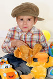 Child with toys. Child playing with toys in home Royalty Free Stock Photography
