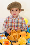 Child with toys. Child playing with toys in home Stock Image