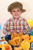 Child with toys. Child playing with toys in home Royalty Free Stock Image