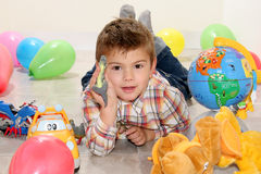 Child with toys. Child playing with toys in home Stock Photography