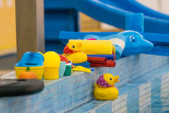 Child toys on pool Stock Photos