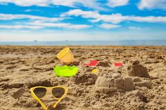 child toys in the sand on the beach Royalty Free Stock Images