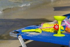 Child toys on a sunbed. On Aliki beach in Thasos Stock Photography