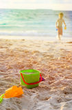 Child toys on sunset beach Stock Photography