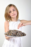 Child with traditional Christmas food kutia Royalty Free Stock Photos