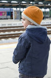 Child at train station Stock Images