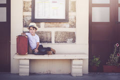 Child in train station Royalty Free Stock Photos