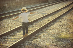 Child on train tracks Stock Photography