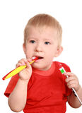 The child is trained to clean a teeth Royalty Free Stock Image