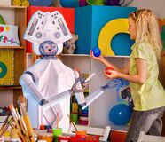 Child training of artificial intelligence by robot. royalty free stock photos