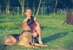 Child trains the dog Stock Image