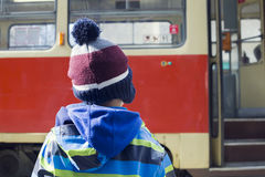 Child at tram stop Stock Images