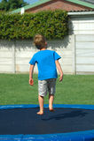 Child on trampoline stock photos